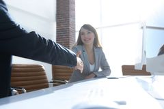 Business partners stretching out their hands for a handshake Stock Photo