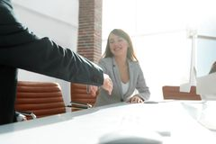 Business partners stretching out their hands for a handshake Stock Images