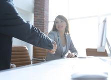 Business partners stretching out their hands for a handshake. Photo with copy space Royalty Free Stock Photo