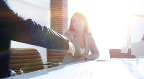 Business partners stretching out their hands for a handshake. Photo with copy space Stock Image