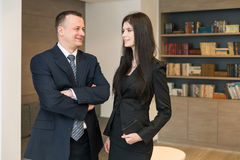 Business partners in suits standing in the room Royalty Free Stock Photography