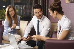 Business partners talking in bar Royalty Free Stock Photos
