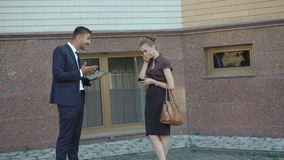 Business partners talking and laughing near the office. 4K stock video footage