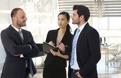 Business partners talking at office royalty free stock images