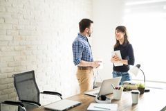 Business partners talking in the office Royalty Free Stock Images