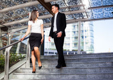 Business partners talking on the stairs royalty free stock images