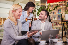 Business partners talking and working in coffee bar Stock Photography