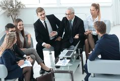 Business partners and business team discussing a new contrac Stock Photo
