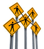 Business Partners. And teamwork concept as a group of traffic signs with people holding hands in agreement connected together as a company organization for team Stock Photo