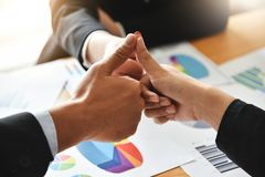 Business partners with thumbs up. Successful of Three business partners with thumbs up Royalty Free Stock Images