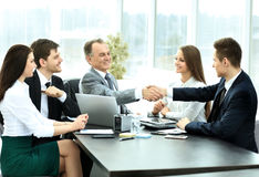 Business partners to discuss cooperation plan for the workplace. Shaking hands during a business meeting business partners in the office Stock Image