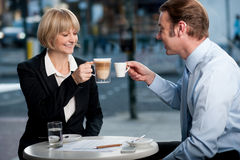Business partners toasting coffee at cafe Royalty Free Stock Photo