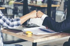 Free Business Partners Trust In Team Giving Fist Bump To Greeting Start Up Project Contractor.Businessman Teamwork Are Partnership In Royalty Free Stock Photo - 155800035