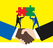 Business partners. Two business partners shake hands and work together Royalty Free Stock Image