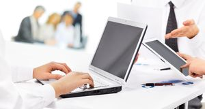 Business Partners Using Laptop Royalty Free Stock Photography