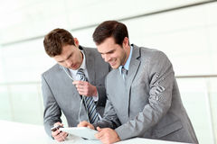 Business partners using tablet in hallway Royalty Free Stock Image