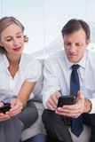 Business partners using their mobile phones Royalty Free Stock Photos