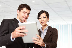 Business partners using touchpad at meeting Stock Photography