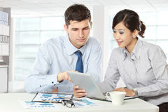 Business partners using touchpad at meeting Royalty Free Stock Images