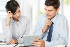 Business partners using touchpad at meeting Stock Image