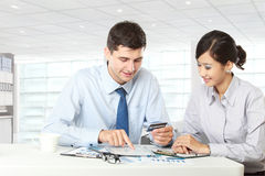 Business partners using touchpad at meeting Stock Photo