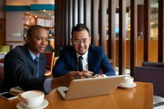 Business partners watching presentation stock photography