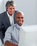 Business partners working at a computer Stock Photos