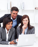 Business partners working at a computer Stock Images