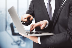 Business partners working with laptop in empty office Royalty Free Stock Images