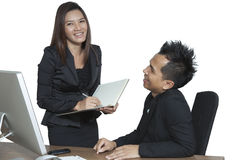 Business partners working at the office on a computer. Happy coworkers working together, discussing work Royalty Free Stock Photos
