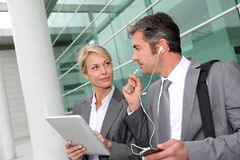 Business partners working with tablet outdoors Royalty Free Stock Photos