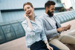 Business partners workmate couple talking in an urban city. Setting Royalty Free Stock Images