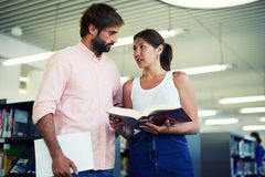 Business partners young girl and a guy talking about the affairs of the company Royalty Free Stock Photography