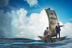 The business partnership with businessmen sailing on dollar boat. Business partnership with businessmen sailing on dollar boat Stock Photo