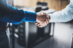 Business partnership handshake concept.Closeup photo of two businessmans handshaking process.Successful deal after great meeting.H Royalty Free Stock Photography