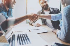 Business partnership handshake concept.Photo coworkers handshaking process.Successful deal after great meeting. Horizontal, blurred background