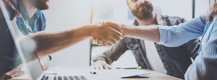 Business partnership handshake concept. Photo two coworkers handshaking process. Successful deal after great meeting. Horizontal, blurred background. Wide