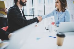 Business partnership handshake.Concept two coworkers handshaking process.Successful deal after great meeting.Blurred. Background Royalty Free Stock Photo