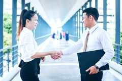 Business partnership handshaking after striking deal outdoors at Royalty Free Stock Images