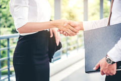 Business partnership handshaking after striking deal outdoors at Stock Image