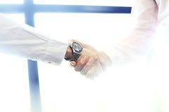 Business partnership meeting concept. Image businessman handshake.Blurred,sunlights Stock Photos