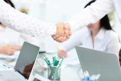 Business partnership meeting concept. Image businessmans handshake. Successful businessmen handshaking after good deal. Horizontal, blurred background in Stock Images