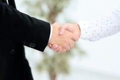 Business partnership meeting concept. Image businessmans handshake. Successful businessmen handshaking after good deal. Horizontal, blurred background stock images
