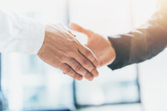 Business partnership meeting. Photo businessmans handshake. Successful businessmen handshaking after good deal Royalty Free Stock Photos