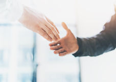 Business partnership meeting photo. Image businessmen handshake. Successful businessmen handshaking after good deal Stock Photo