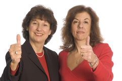 Business partnership success. Thumbs up for female business partnership happy and successful Royalty Free Stock Image