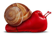 Business Patience. Noncompetitive crisis and inferior competitive skill as a red boxing glove shaped as a snail in a unambitious metaphor for lack of innovation Royalty Free Stock Photos