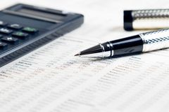 Business pen, calculator on financial chart Royalty Free Stock Photography