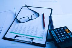 Business pen, calculator and glasses on financial chart. Business concept Royalty Free Stock Image