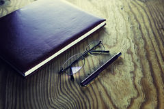 Business pen glasses notebook Royalty Free Stock Photo